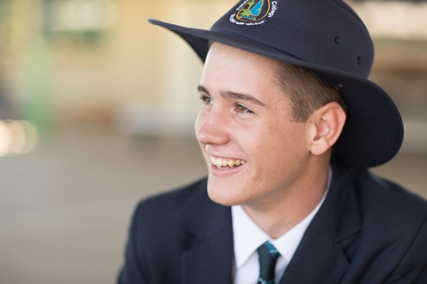 Male student smiling away from camera